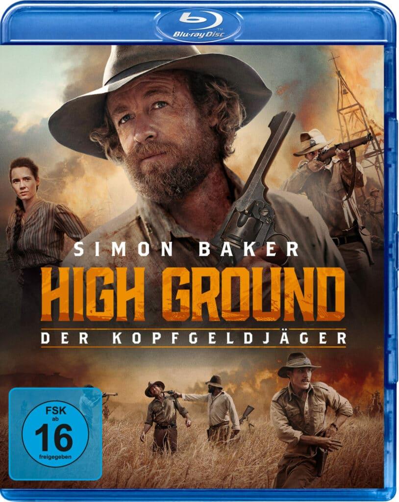 Das Konterfei von Simon Baker prangt über dem Titel, um ihn herum Impressionen actionreicher Abenteuer im australischen Outback auf dem Cover zu High Ground - Der Kopfgeldjäger