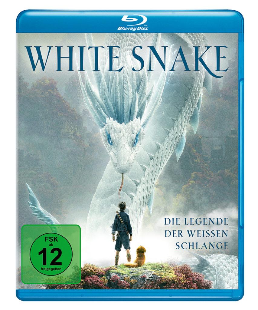 Ah Xuang und Hund Dudou stehen vor der riesigen weißen Schlange auf dem Cover von White Snake - Die Legende der weißen Schlange.