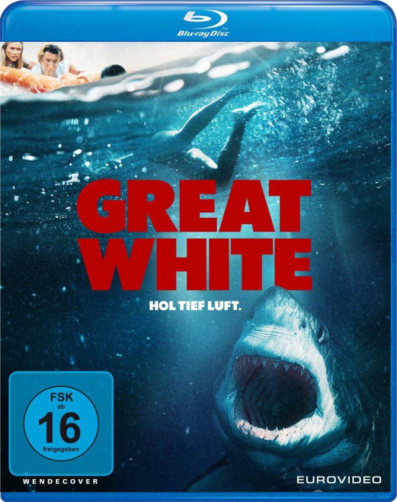 Das Cover zeigt einen weißen Hai, der mit aufgerissenem Maul nach einem im Wasser schwimmenden Menschen schnappen möchte.