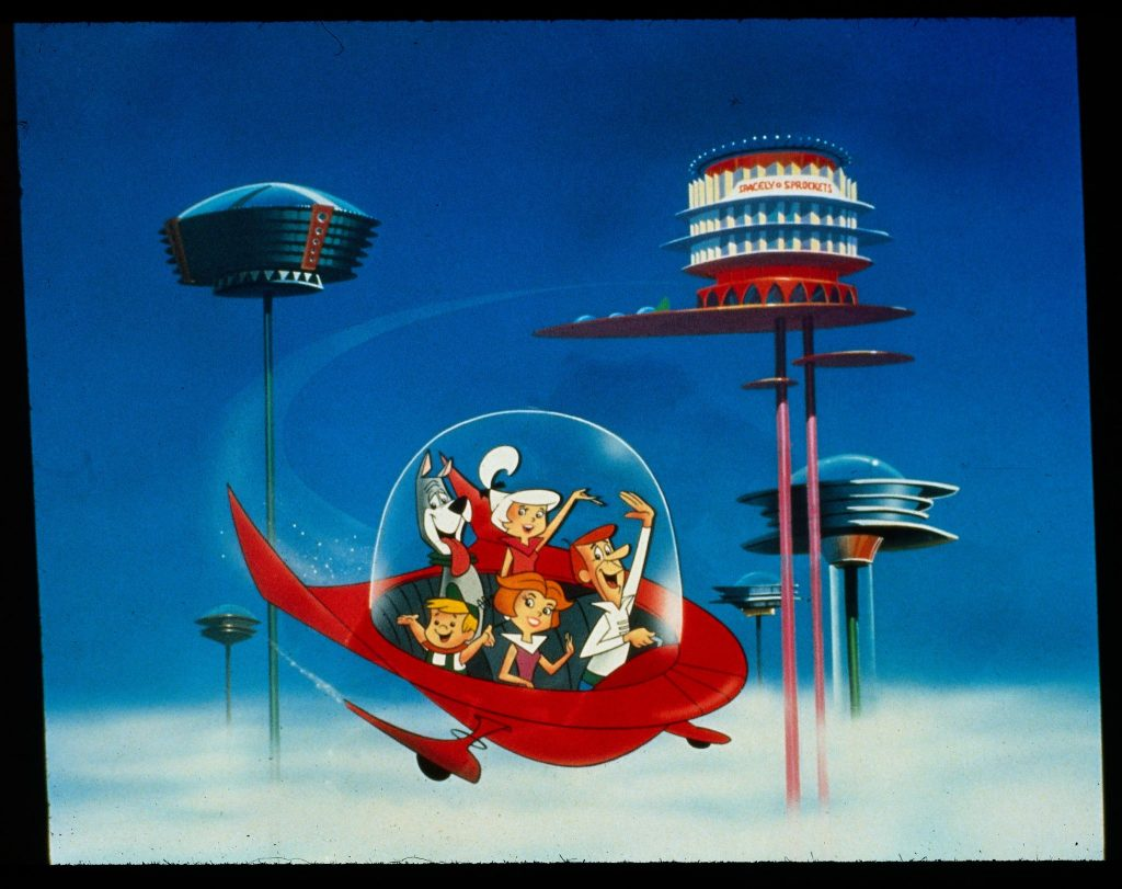 Die Jetsons fliegen in ihrem fliegenden Gefährt durch den Himmel ihres Heimatplanetens