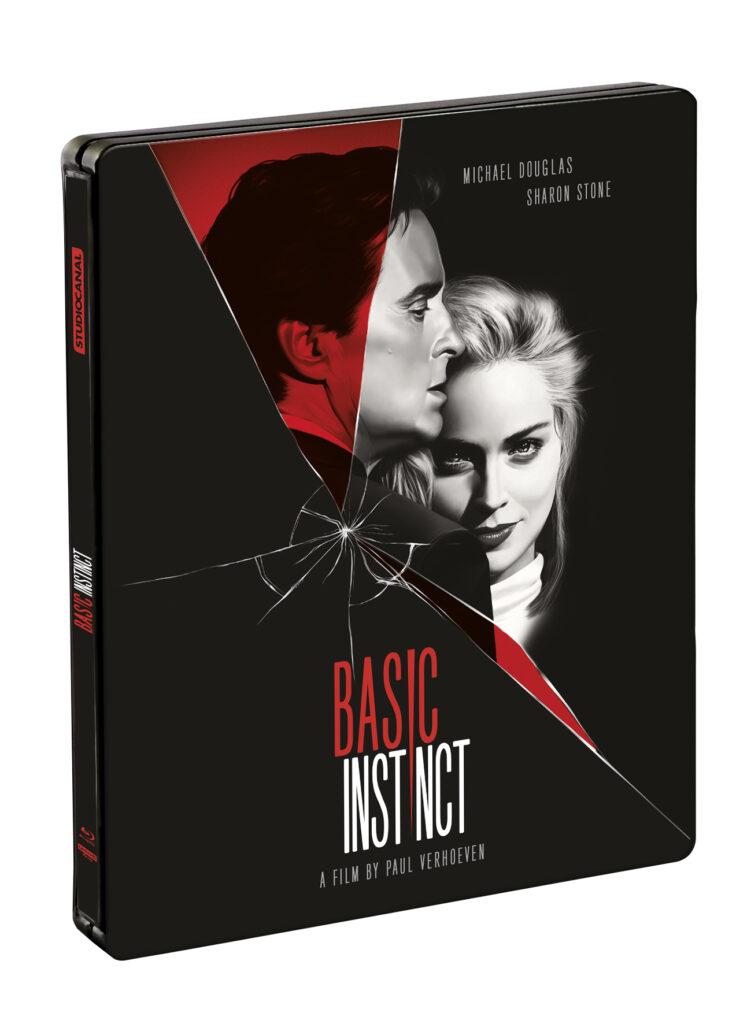 """Das 4K Steelbook zu """"Basic Instinct"""" ist grundlegend in schwarz gehalten. Der Filmtitel steht teils in roter, teils in weißer Schrift im unteren Bereich. Über das Cover hinweg sind die beiden Hauptdarsteller Michael Douglas und Sharon Stone in schwarz-weiß zu sehen und auch teils in rot. Unterhalb von Douglas Gesicht, welches zur Seite blickt, ist eine Zersplitterung, wie von zerbrochenem Glas zu erkennen."""