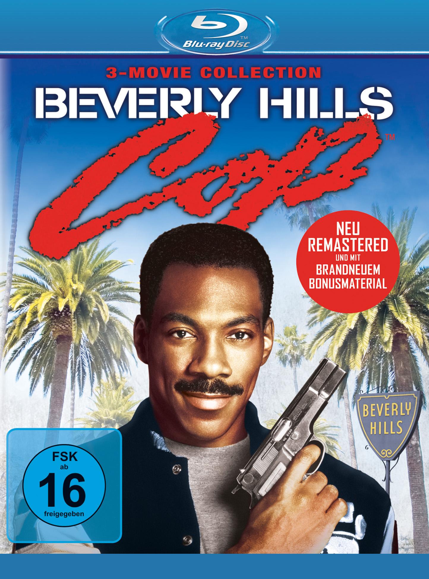 Auf dem Cover zur Remastered-Box der Beverly Hills Cop-Trilogie ist Eddie Murphy grinsend in Großaufnahme zu sehen, die Pistole an die Brust angelegt.
