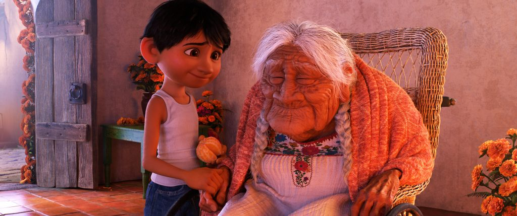 """COCO (Pictured) - FAMILY BONDS - In Disney•Pixar's """"Coco,"""" Miguel (voice of Anthony Gonzalez) has a very special relationship with his great-great-grandmother, Mamá Coco (voice of Ana Ofelia Murguía). Directed by Lee Unkrich and co-directed by Adrian Molina, Disney•Pixar's """"Coco,"""" opens in U.S. theaters on Nov. 22, 2017. ©2017 Disney•Pixar. All Rights Reserved."""