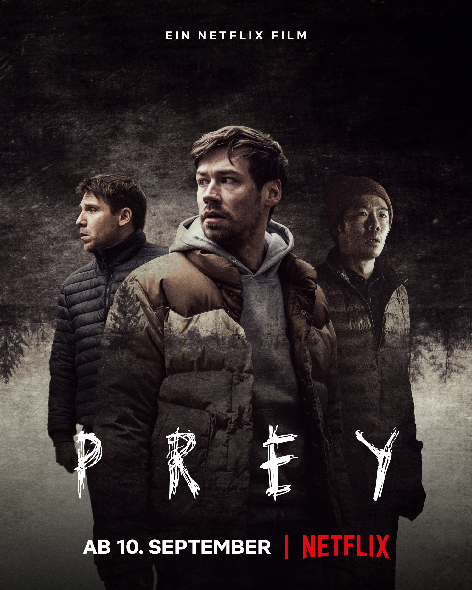 Das deutsche Plakat zum Film Prey zeigt die Hauptfigur Roman in der Mitte und links und rechts daneben zwei Begleiter. Unten im Bild steht das Startdatum, der 10. September.