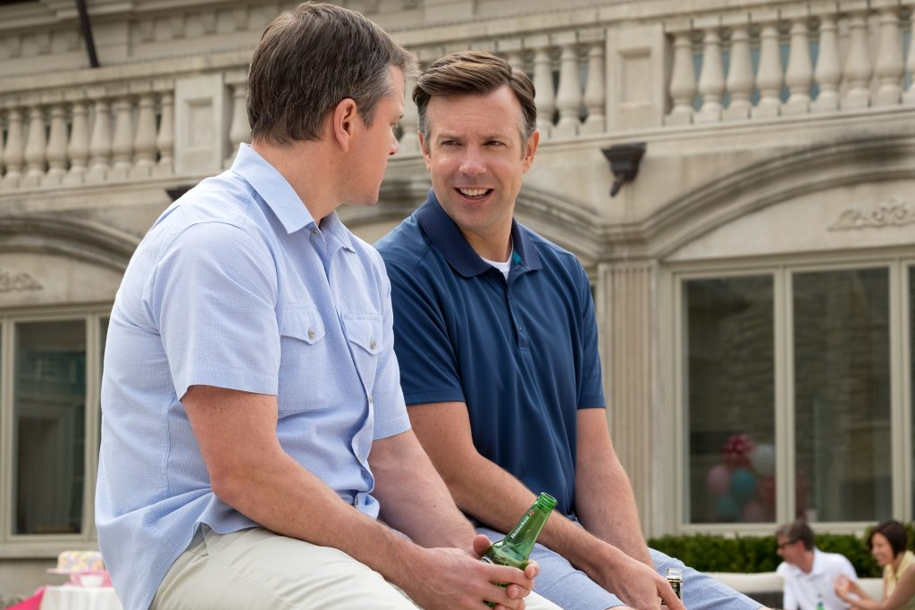 Jason Sudeikis plays Dave Johnson and Matt Damon plays Paul Safranek in Downsizing from Paramount Pictures.