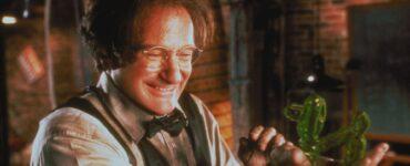 Robin Williams hält grinsend eine grüne Masse in der Hand - Die 10 besten Robin Williams Filme