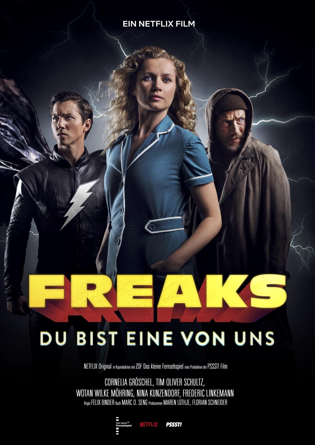 Das Poster des Films Freaks - Du bist eine von uns zeigt die drei Protagonisten vor Blitzen im Hintergrund