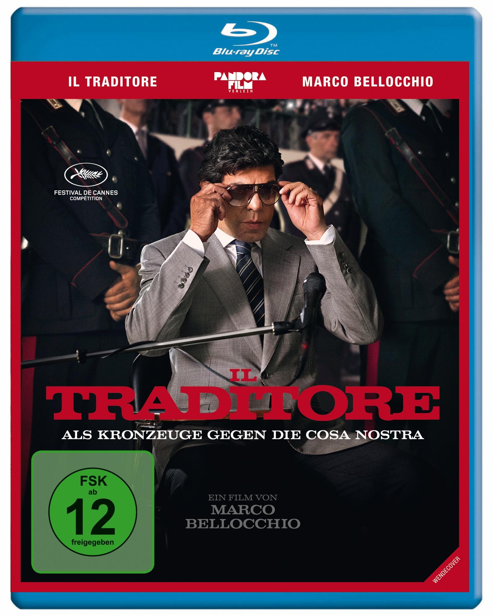 Das Cover der Blu-ray zu Il Traditore - Als Kronzeuge gegen die Cosa Nostra zeigt Hauptfigur Tommaso Buscetta im Anzug vor Gericht - und mit Sonnenbrille.