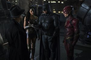 J.K. SIMMONS as Commissioner Gordon, GAL GADOT as Wonder Woman, BEN AFFLECK as Batman and EZRA MILLER as The Flash in Justice League from 2017