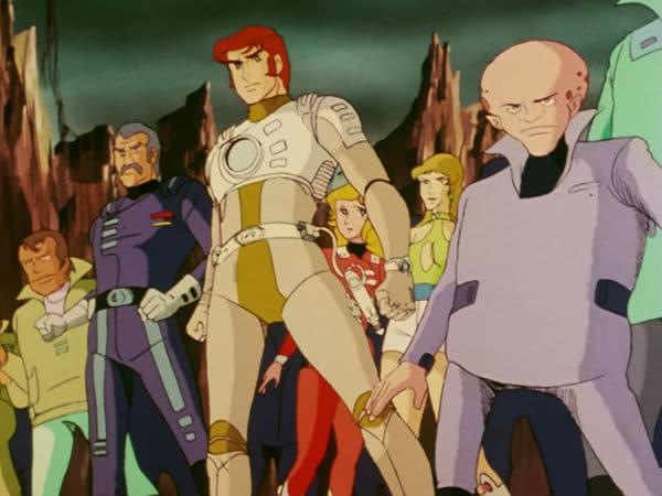 Captain Future zählt zu den Kinderserien der 80er. Die Hauptfigur und einige weitere Figuren stehen angespannt und mit ernsten Gesichtsausdruck Seite an Seite.
