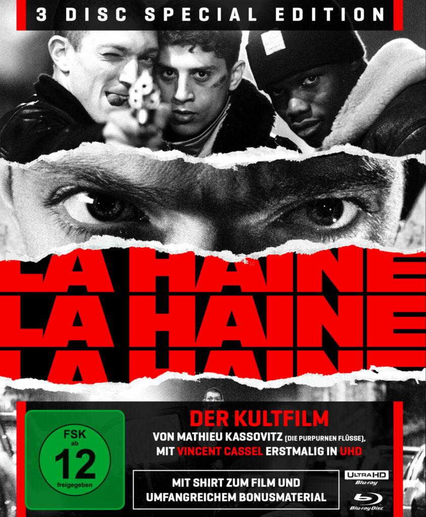 Auf dem Cover sieht man im oberen Drittel die drei Freunde Vinz, Said und Hubert mit einer Waffe, in der Mitte eine Großaufnahme von Vinz' Augen und darunter den Originaltitel La Haine, der sich in roten Lettern von oben nach unten wiederholt - Hass