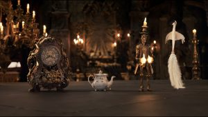 The mantel clock Cogsworth, the teapot Mrs. Potts, Lumiere the candelabra and the feather duster Plumette live in an enchanted castle in Disney's BEAUTY AND THE BEAST the live-action adaptation of the studio's animated classic directed by Bill Condon. © The Walt Disney Company Germany GmbH