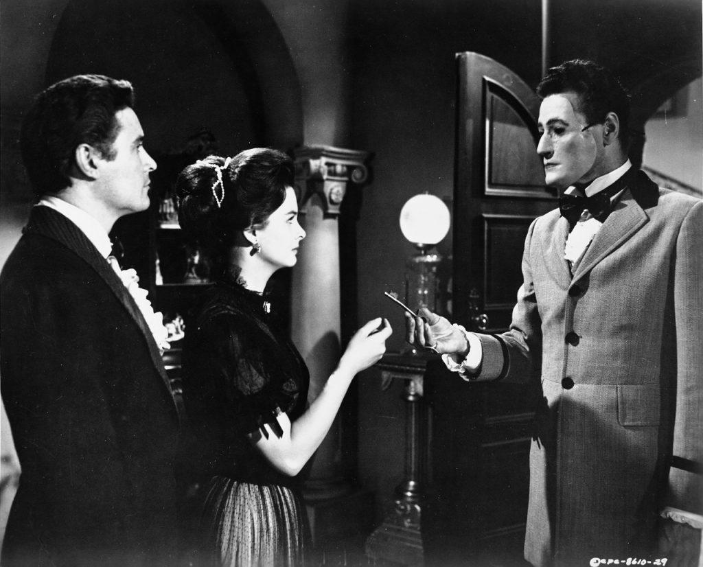 Sardonicus übergibt Cargrave und Maude den Schlüssel zu einem geheimen Zimmer