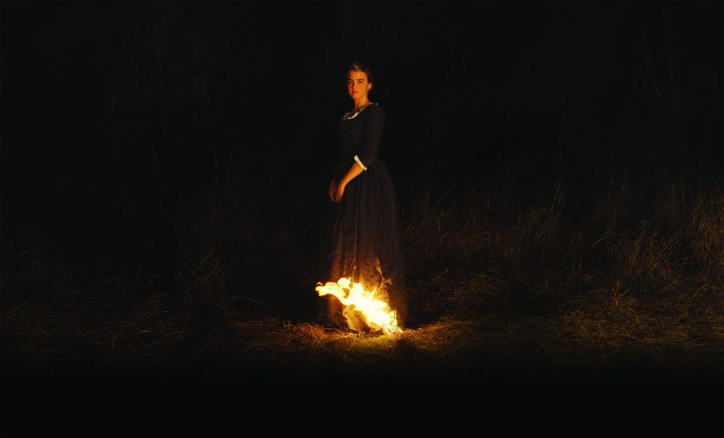 Héloïses Kleid fängt Feuer und lässt somit einen kleinen Teil der Dunkelheit erleuchten in Porträt einer jungen Frau in Flammen