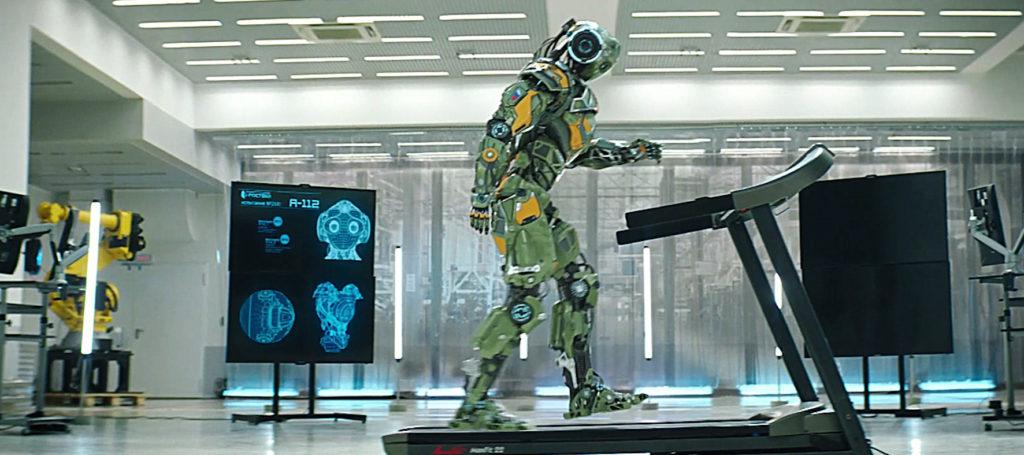 Titelheld Robo auf einem Laufband im Forschungslabor.