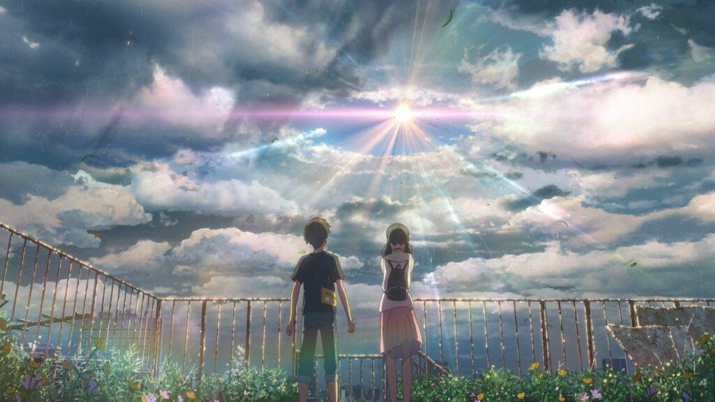 Die Hauptfiguren Hokada und Hina stehen auf einem Dach. Als Beobachter stehen wir weit hinter diesen und beobachten, wie Hina für Sonnenschein betet - Streamcatcher Podcast Februar 2021.