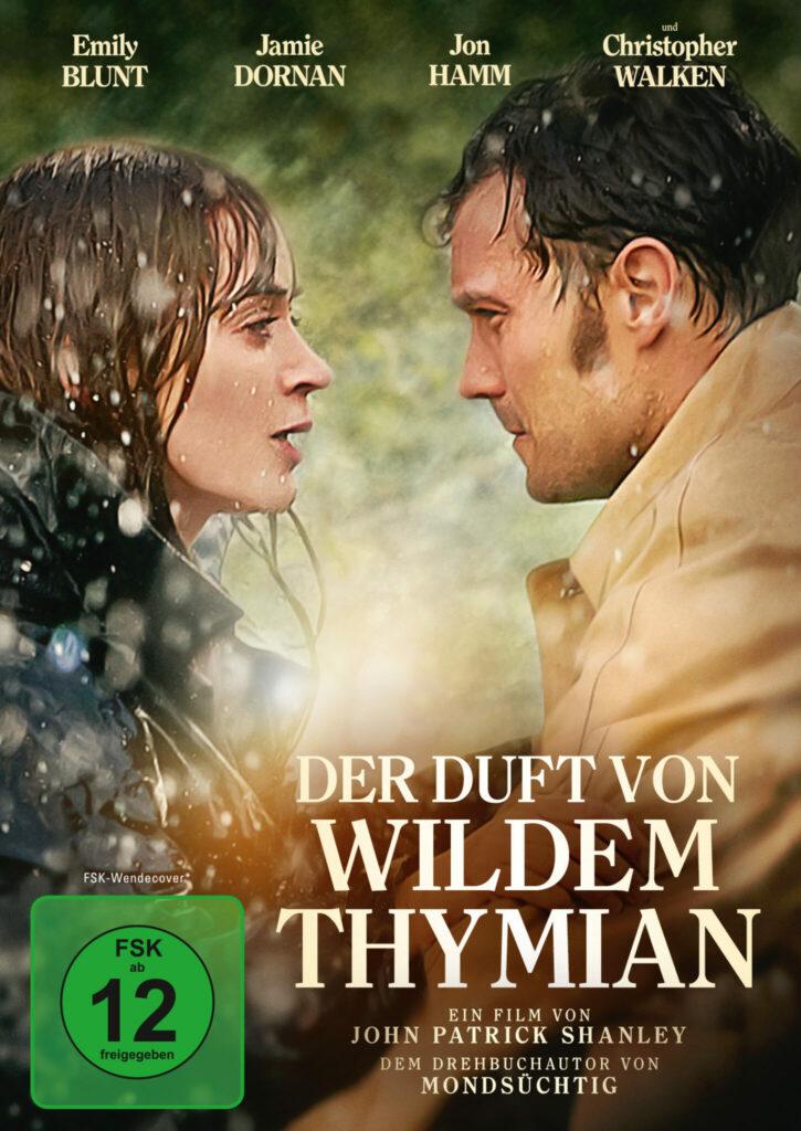 """Coverbild von """"Der Duft von wildem Thymian"""". Zu sehen sind Rosemary Muldoon (Emily Blunt) und nthony Reilly (Jamie Dornan) im Regen."""