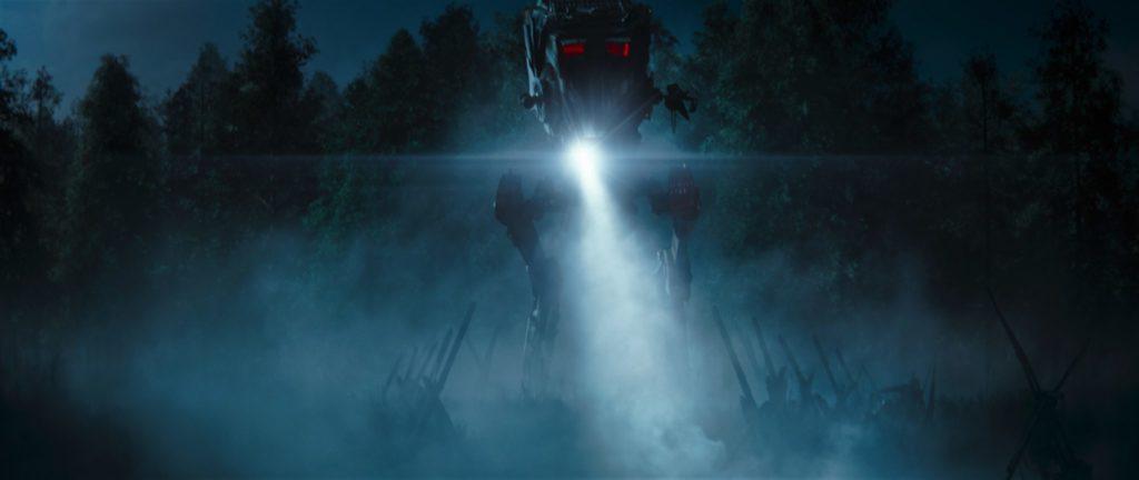 Ein heruntergekommener, imperialer AT-ST macht nachts mit seinem Suchscheinwerfer Jagd auf seine Beute.