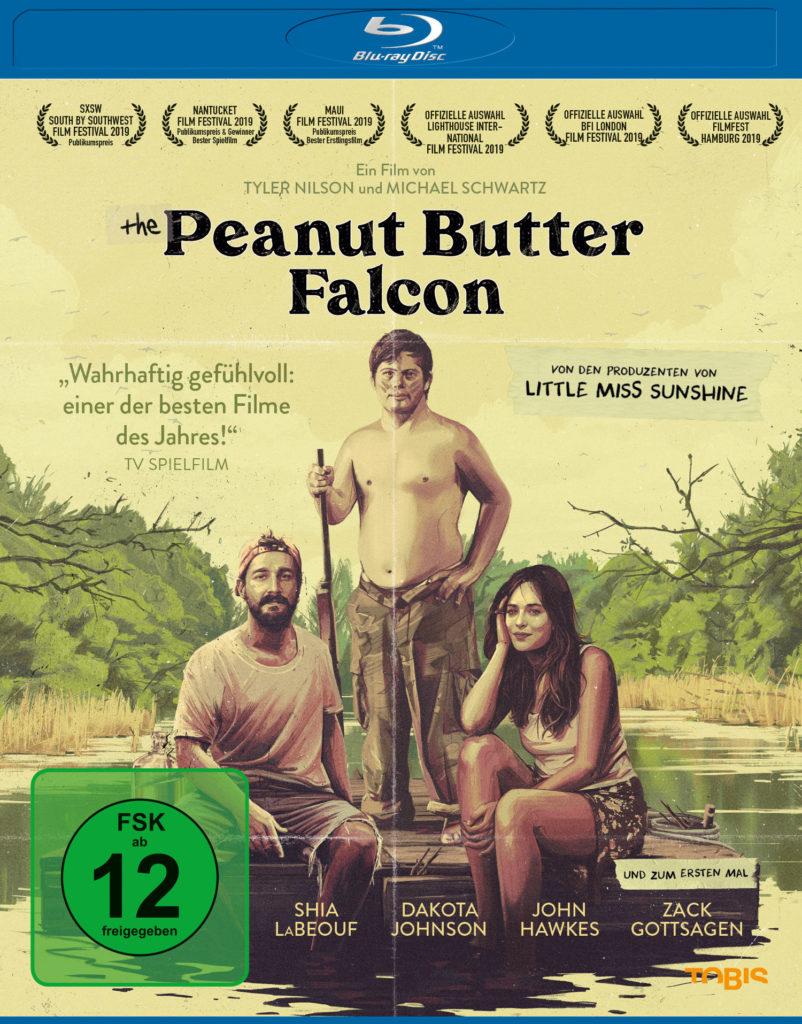 Zak (Zack Gottsagen), Terry (Shia LaBeouf) und Eleanor (Dakota Johnson) befinden sich auf einem Floß in The Peanut Butter Falcon