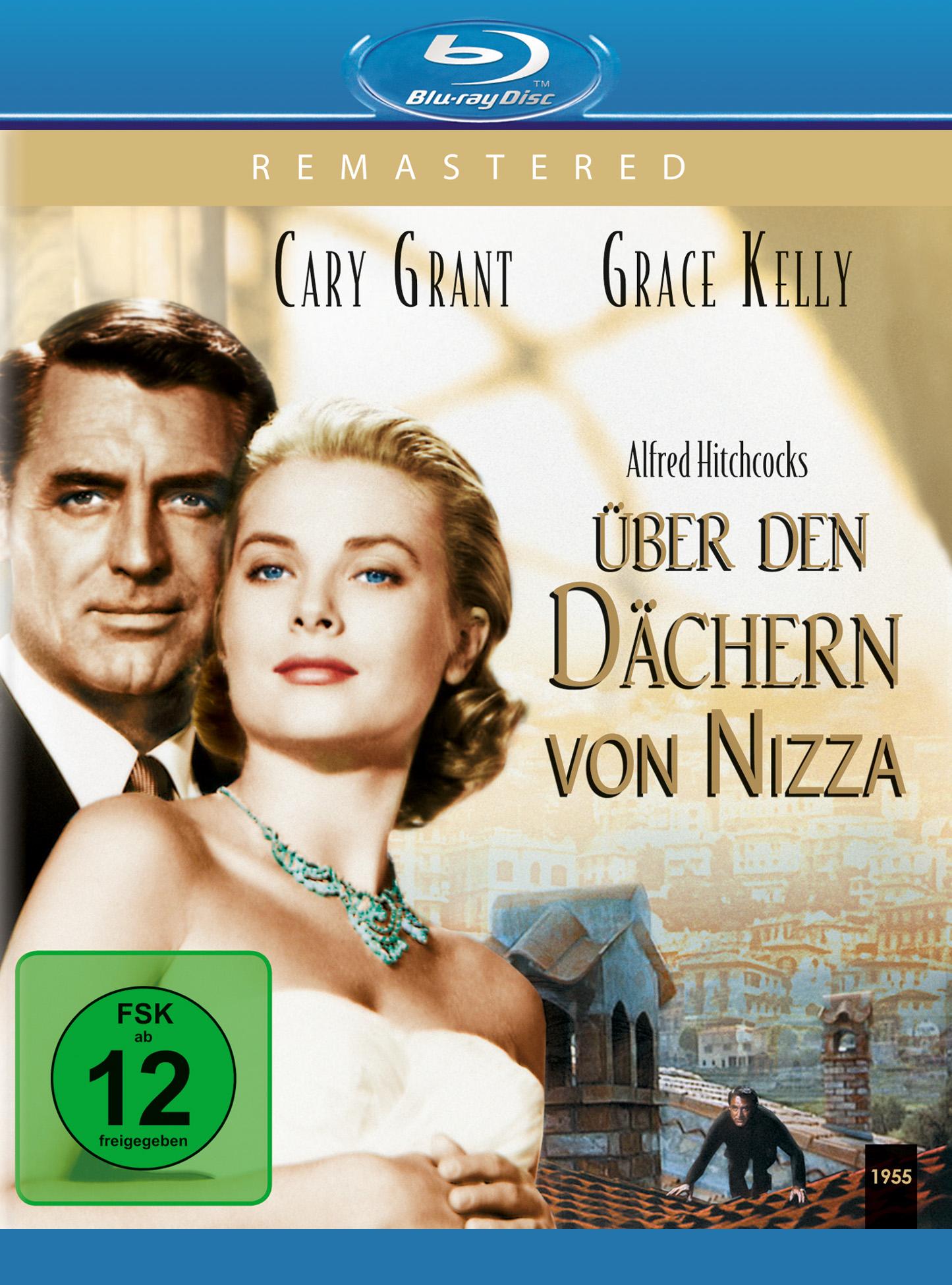 Auf dem Cover der Remastered Blu-ray von Über den Dächern von Nizza sehen wir links vor goldfarbenem Hintergrund die Hauptdarsteller Cary Grant und Grace Kelly sich aneinander schmiegen. Unten rechts ist in klein ein Szenenbild zu sehen, in der der von Cary Grant gespielte John Robie katzenhaft über ein Hausdach schleicht.