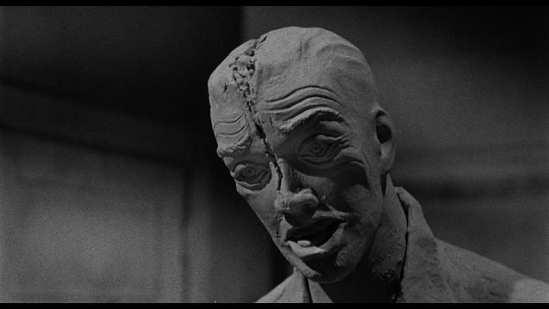 Ein modellierter, toter Mann mit immer noch sichtbarer Spaltung des Schädels in Das Vermächtnis des Prof. Bondi