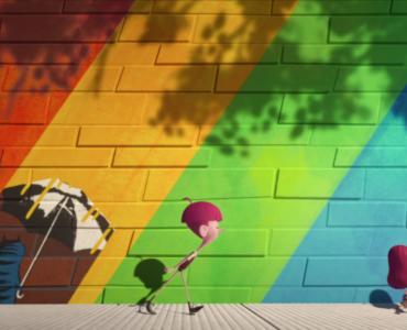 Die Kinder stehen zusammen vor einer bunten Mauer