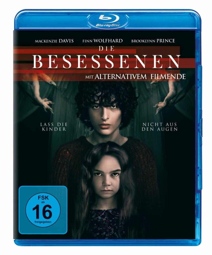 Das Blu-ray-Cover von Die Besessenen mit Brooklynn Prince und Finn Wolfhard voreinander stehend