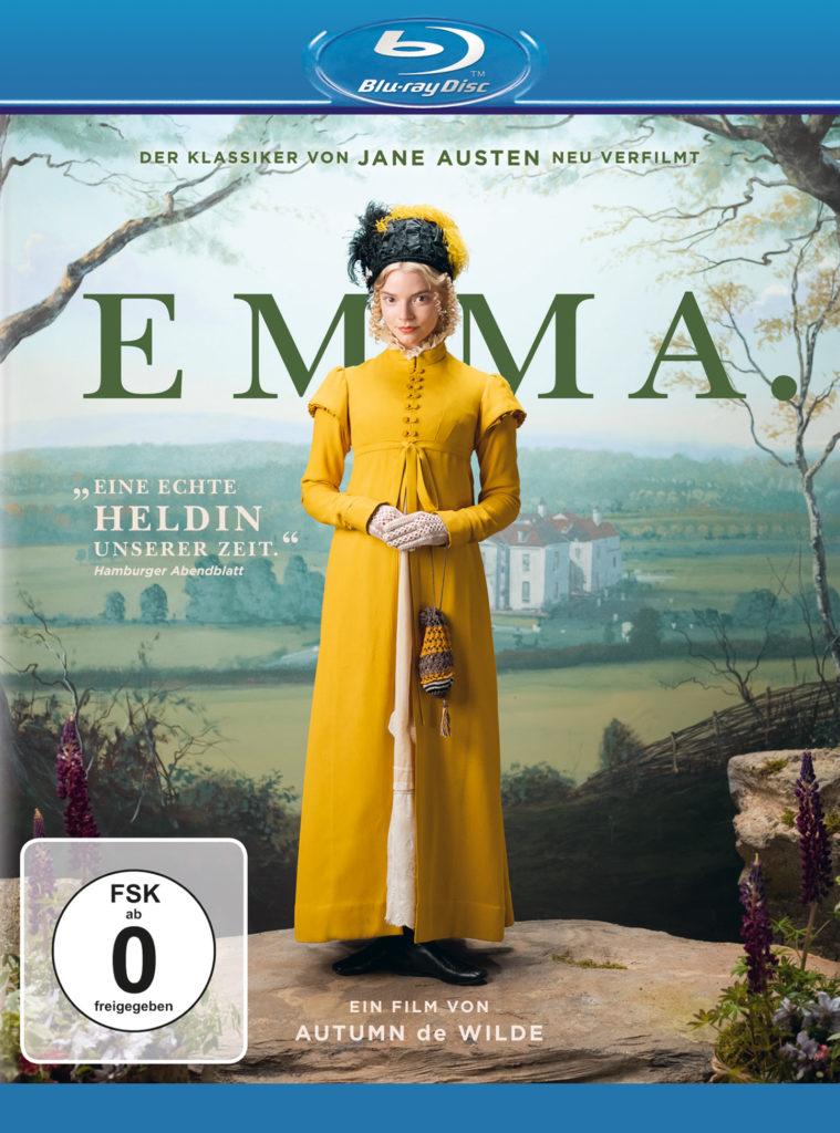 Das Blu-ray-Cover von Emma zeigt Anya Taylor-Joy in der Titelrolle in einem gelben Kleid auf einem Felsvorsprung stehend vor einer malerischen Landschaftskulisse.