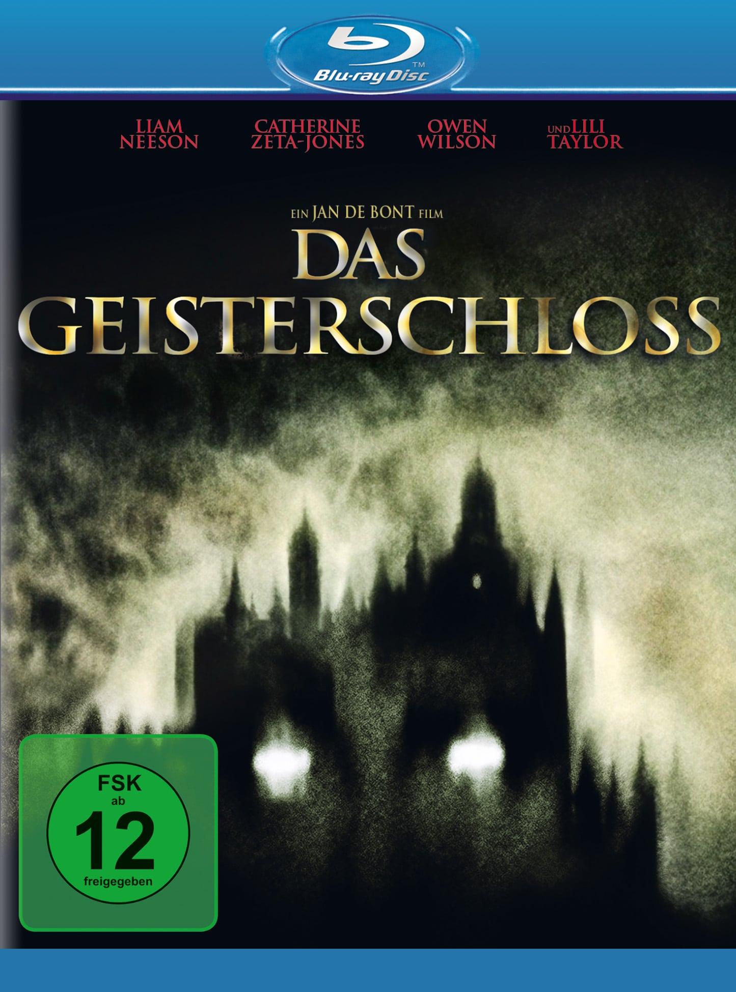 Auf dem Cover von Das Geisterhaus ist ein dunkles Schloss im Nebel zu sehen, dessen schwarze Türme in den Himmel ragen und auf das ein Gesicht mit leuchtenden Augen projiziert ist.