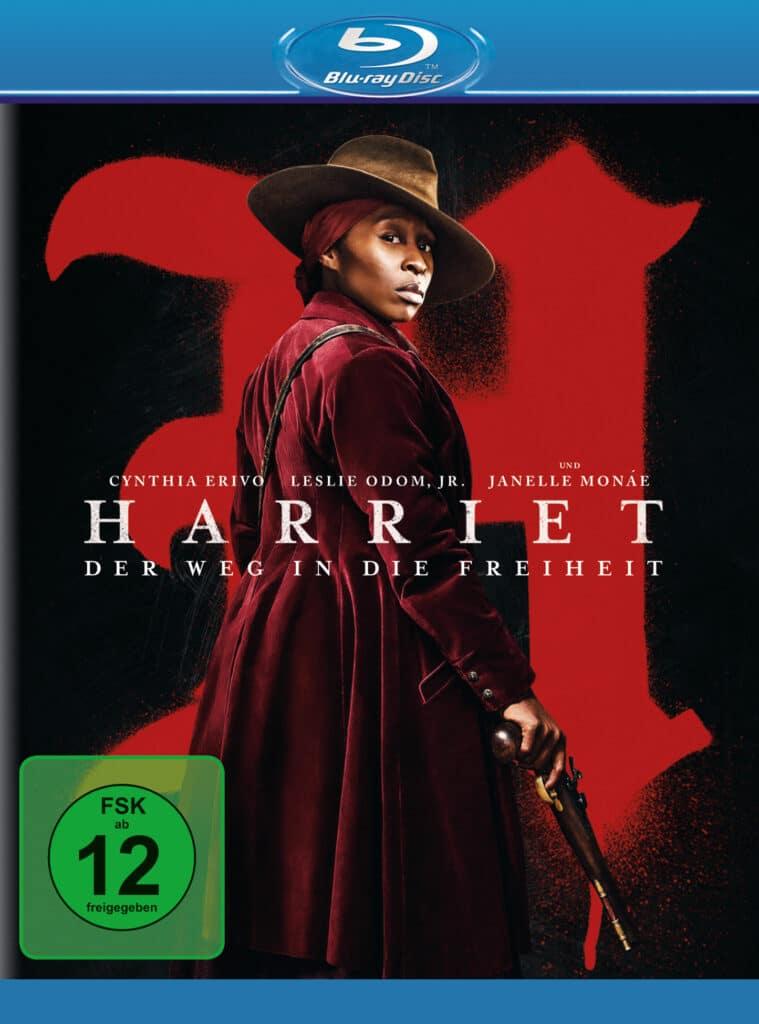 Auf dem Cover zu Harriet - Der Weg in die Freiheit posiert Harriet Turbman (Cynthia Erivo) mit Mantel, Hut und Pistole
