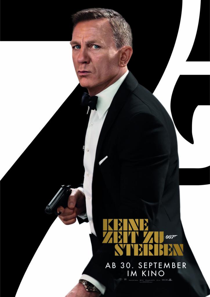Daniel Craig als James Bond in seinem klassischen Anzug mit Pistole in der Hand auf dem Plakat von Keine Zeit zu sterben