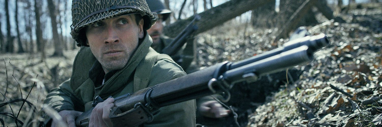Lieutenant Cappa liegt in einem Schützengraben, Schlacht in den Ardennen, Tiberius Film
