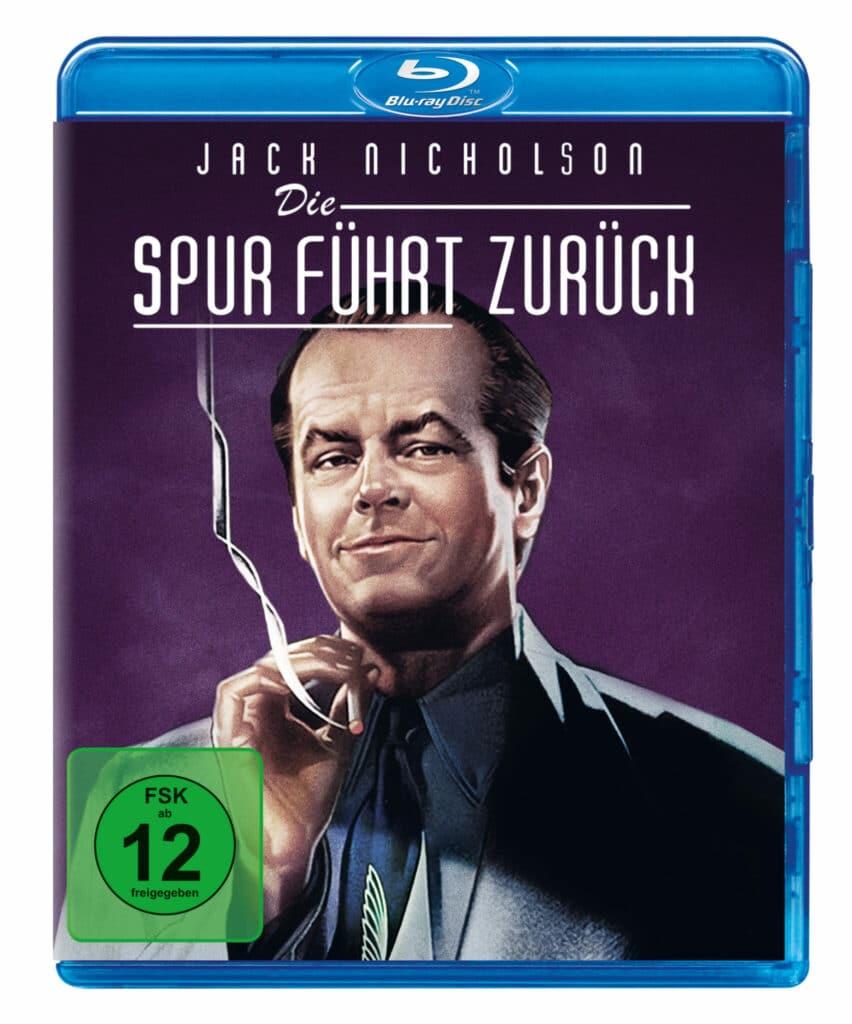 Front-Covermotiv der Blu-ray-Veröffentlichung zu Die Spur führt zurück zeigt einen gezeichneten Jack Nicholson rauchend vor lilafarbenen Hintergrund.