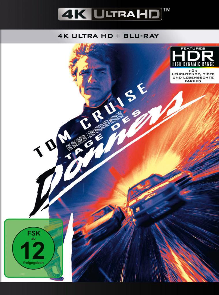 Das deutsche Cover der 4K UHD von Tage des Donners zeigt auf der linken Seite hauptsächlich eine weiße Fläche. In der Mitte ist Tom Cruise zu sehen. Unterhalb seines Kopfs kommen die Schriftzüge mit seinem Namen und dem Titel des Films. Diese sind Diagonal, aber zentriert. Die rechte Hälfte ist farblich sehr bunt. Hauptsächlich in rot, gelb und orange. Man erkennt dabei zwei Rennautos die über eine Strecke fahren.