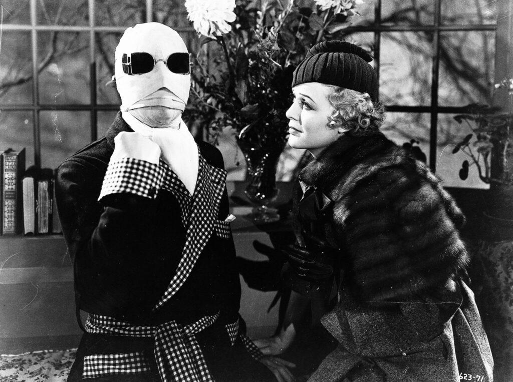 Der unsichtbare, in Mullbinden gehüllte Dr. Griffin zeigt seiner Verlobten Flora die kalte Schulter - Universal Horror Filme